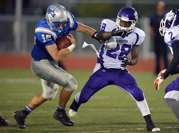 Broomfield's Connor Eakes runs and prevents a tackle by Denver South's Pete Williams during Friday's game at Elizabeth Kennedy Stadium.<br /> September 28, 2012<br /> staff photo/ David R. Jennings