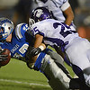 Broomfield's Ryan McCulley is tackled by  Denver South's Zachary Lindsay during Friday's game at Elizabeth Kennedy Stadium.<br /> September 28, 2012<br /> staff photo/ David R. Jennings