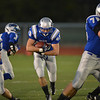 Broomfield's D.J. Zissimos runs through  Denver South's line during Friday's game at Elizabeth Kennedy Stadium.<br /> September 28, 2012<br /> staff photo/ David R. Jennings