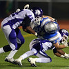 Broomfield's Ryan McCulley is tackled by  Denver South's Johnny Coleman (44) and Shun Johnson during Friday's game at Elizabeth Kennedy Stadium.<br /> September 28, 2012<br /> staff photo/ David R. Jennings