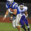 Broomfield's Connor Eakes as quarterback keeps the ball running away from Denver South's Zachary Lindsay during Friday's game at Elizabeth Kennedy Stadium.<br /> September 28, 2012<br /> staff photo/ David R. Jennings