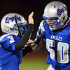 Broomfield's quarterback Simeon Combs, left, and Justin DiMichele cheer during Friday's game against Denver South at Elizabeth Kennedy Stadium.<br /> September 28, 2012<br /> staff photo/ David R. Jennings