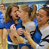 Broomfield's coach Erika Taga. left. and Gabby Maiden, right, congratulate Melanie Stelling after receiving a 9.9 for  her performance on the beam at the state 5A gymnastics competition at Thornton High School on Friday<br /> <br /> November 2, 2012<br /> staff photo/ David R. Jennings