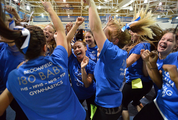 Gabby Maiden, center, celebrates with the Broomfield gymnastics team after the Eagles won the state 5A gymnastics competition at Thornton High School on Friday<br /> <br /> November 2, 2012<br /> staff photo/ David R. Jennings