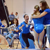 Broomfield's Gabby Maiden, center, and Melanie Stelling run to hug Kailey Licata after her performance on the uneven parallel bars at  and coach Erika Taga during the 5A gymnastics competition at Thornton High School on Friday.<br /> <br /> November 2, 2012<br /> staff photo/ David R. Jennings