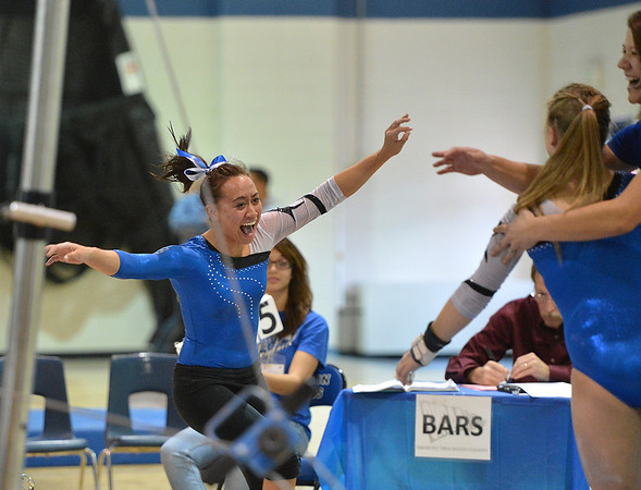 Broomfield's Gabby Maiden runs to hug Kailey Licata after her performance on the uneven parallel bars at the 5A gymnastics competition at Thornton High School on Friday.<br /> <br /> <br /> November 2, 2012<br /> staff photo/ David R. Jennings
