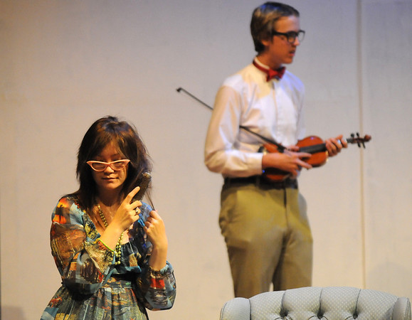 Sarah Espinoza, left, playing Fairy Mae, brushes her hair while Shane Black, playing Hannibal, holds his violin during rehearsal for the Broomfield High production of Curious Savage on Wednesday.<br /> <br /> October 7, 2009<br /> Staff photo/David R. Jennings