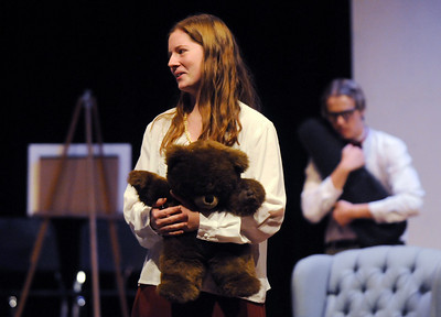 Megan Brunson, left, playing Mrs. Savage, holds her teddy bear while talking as Shane Black, playing Hannibal, holds his violin in the background during rehearsal for the Broomfield High production of Curious Savage on Wednesday.  October 7, 2009 Staff photo/David R. Jennings
