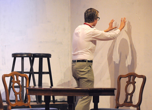 Shane Black, playing Hannibal, does something imaginary with the wall during rehearsal for the Broomfield High production of Curious Savage on Wednesday.<br /> <br /> October 7, 2009<br /> Staff photo/David R. Jennings