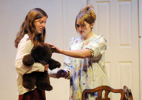 Megan Brunson, left, playing Mrs. Savage, lets Shannon Bradley, playing Mrs. Paddy, touch her teddy bear during rehearsal for the Broomfield High production of Curious Savage on Wednesday.<br /> <br /> October 7, 2009<br /> Staff photo/David R. Jennings