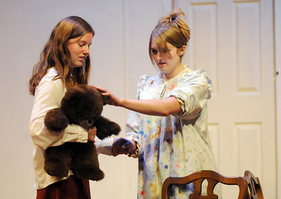 Megan Brunson, left, playing Mrs. Savage, lets Shannon Bradley, playing Mrs. Paddy, touch her teddy bear during rehearsal for the Broomfield High production of Curious Savage on Wednesday.  October 7, 2009 Staff photo/David R. Jennings