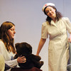 BE1011PLAY02<br /> Megan Brunson, left, playing Mrs. Savage, holds a teddy bear while listening to Tristine Henderson, playing the nurse Miss Wilhelmina, during rehearsal for the Broomfield High production of Curious Savage on Wednesday.<br /> <br /> October 7, 2009<br /> Staff photo/David R. Jennings