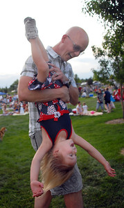 Blake Sevier plays with his daughter Vivian, 3, during the Great American Picnic at the Broomfield County Commons Park on Monday.  July 4, 2011 staff photo/ David R. Jennings