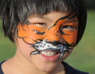 Rosy McKeralt-Gould, 6, had her face painted as a tiger during the Great American Picnic at the Broomfield County Commons Park on Monday.  July 4, 2011 staff photo/ David R. Jennings