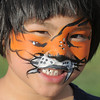 Rosy McKeralt-Gould, 6, had her face painted as a tiger during the Great American Picnic at the Broomfield County Commons Park on Monday.<br /> <br /> July 4, 2011<br /> staff photo/ David R. Jennings