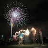 Teenagers play with sparklers during the fireworks display at the Great American Picnic at the Broomfield County Commons Park on Monday.<br /> <br /> July 4, 2011<br /> staff photo/ David R. Jennings