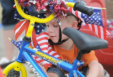 Devon Micheletti, 5, adjusts flags on his bicycle before the bike parade during the Great American Picnic at the Broomfield County Commons Park on Monday.  July 4, 2011 staff photo/ David R. Jennings