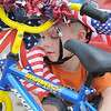 Devon Micheletti, 5, adjusts flags on his bicycle before the bike parade during the Great American Picnic at the Broomfield County Commons Park on Monday.<br /> <br /> July 4, 2011<br /> staff photo/ David R. Jennings