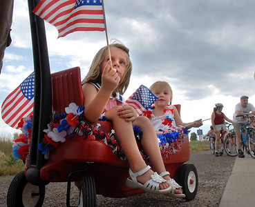 Lauren Micheletti, 4, left, and her sister Emily, 2, wait in their wagon for the bike parade during the Great American Picnic at the Broomfield County Commons Park on Monday.  July 4, 2011 staff photo/David R. Jennings