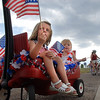 Lauren Micheletti, 4, left, and her sister Emily, 2, wait in their wagon for the bike parade during the Great American Picnic at the Broomfield County Commons Park on Monday.<br /> <br /> July 4, 2011<br /> staff photo/David R. Jennings