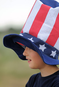 Max Gaston, 10 1/2, wore a big Uncle Sam hat during the Great American Picnic at the Broomfield County Commons Park on Monday.  July 4, 2011 staff photo/ David R. Jennings