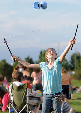 Katherine Tutt, 10, catches a spool while playing Diablo during the Great American Picnic at the Broomfield County Commons Park on Monday.<br /> <br /> July 4, 2011<br /> staff photo/ David R. Jennings