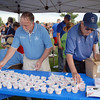 City Council member Dennis McClosky, left, and Mayor Pat Quinn set out ice cream for people during the Great American Picnic at the Broomfield County Commons Park on Monday.<br /> <br /> July 4, 2011<br /> staff photo/ David R. Jennings