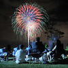 Spectators watch the extended fireworks display during the Great American Picnic at the Broomfield County Commons Park on Monday.<br /> <br /> July 4, 2011<br /> staff photo/ David R. Jennings