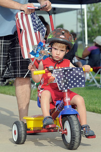 Matthew Souza, 2 1/2, riding in the bike parade during the Great American Picnic at the Broomfield County Commons Park on Monday.  July 4, 2011 staff photo/ David R. Jennings