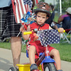 Matthew Souza, 2 1/2, riding in the bike parade during the Great American Picnic at the Broomfield County Commons Park on Monday.<br /> <br /> July 4, 2011<br /> staff photo/ David R. Jennings