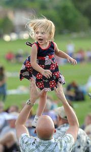 Vivian Sevier, 3, is tossed in the air by her father Blake during the Great American Picnic at the Broomfield County Commons Park on Monday.  July 4, 2011 staff photo/ David R. Jennings