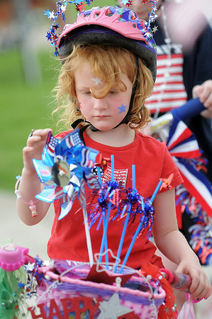 Kensie Kirby, 4, looks at her decorations on her bicycle during the bike parade at the Great American Picnic at the Broomfield County Commons Park on Monday.<br /> <br /> July 4, 2011<br /> staff photo/ David R. Jennings