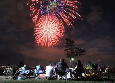 Spectators watch the extended fireworks display during the Great American Picnic at the Broomfield County Commons Park on Monday. July 4, 2011 staff photo/ David R. Jennings