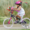 Isabella Martinez, 7, rides her bicycle during the bike parade at the Great American Picnic at the Broomfield County Commons Park on Monday.<br /> <br /> July 4, 2011<br /> staff photo/ David R. Jennings