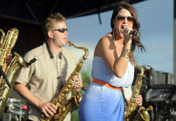 Funkiphino lead vocalist, Brittany Loan, entertains the crowd during the Great American Picnic at the Broomfield County Commons Park on Monday.<br /> <br /> July 4, 2011<br /> staff photo/ David R. Jennings