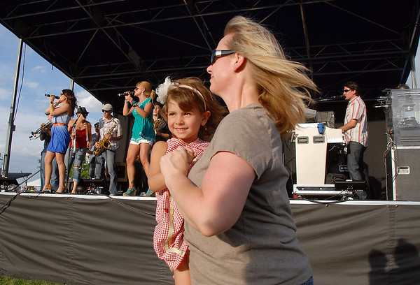 Natalie Reagan dances with her niece Italia Coone, 4, to the music of Funkiphino during the Great American Picnic at the Broomfield County Commons Park on Monday.<br /> <br /> July 4, 2011<br /> staff photo/ David R. Jennings