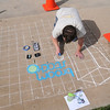 Chalk artist Eric Matelski creats a drawing of the Broomstock 2010 poster during Thursday's Broomstock 2010 at the Broomfield County Commons. <br /> May 27, 2010<br /> Staff photo/ David R. Jennings