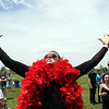 Carter James, 21, dances wearing a red boa during Thursday's Broomstock 2010 at the Broomfield County Commons. <br /> May 27, 2010<br /> Staff photo/ David R. Jennings