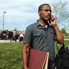 Air Dubai's vocalist Jon Shockness makes a call after finding out the band won the contest to open for One Republic playing later on  Thursday at 1st BankCenter after Broomstock 2010.<br /> May 27, 2010<br /> Staff photo/ David R. Jennings