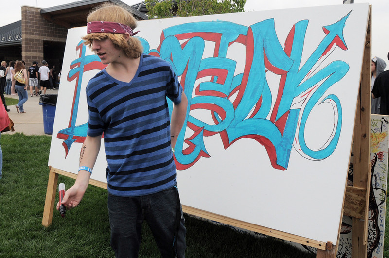 William Zensen, 15, makes graffiti art during Broomstock at the Broomfield County Commons Park on Thursday.<br /> May 26, 2011<br /> staff photo/David R. Jennings