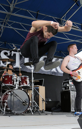 Adam Parker lead vocals for No Less Than Victory sings and  jumps  during a song at Broomstock at the Broomfield County Commons Park on Thursday.<br /> May 26, 2011<br /> staff photo/David R. Jennings