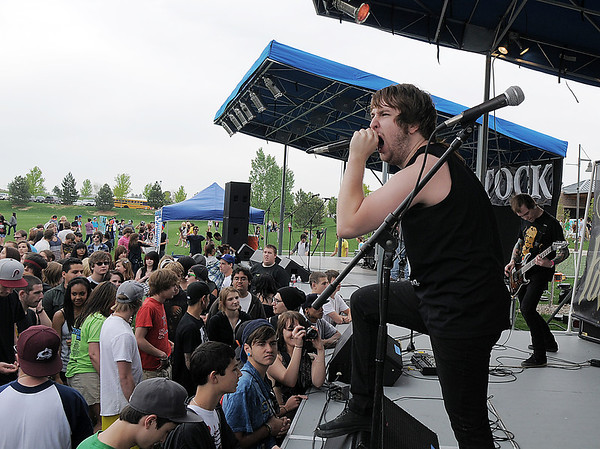 Taylor MacNicholas, lead vocals for 'Forty Fathoms' during Broomstock at the Broomfield County Commons Park on Thursday.<br /> May 26, 2011<br /> staff photo/David R. Jennings