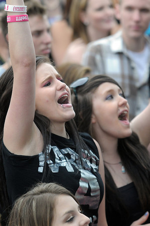 be0529Bstock13<br /> Brandi Holdridge, 20, left, and Nikki Rice, 17, sing and cheer during the perofrmance of Be Brave at Broomstock at the Broomfield County Commons Park on Thursday.<br /> May 26, 2011<br /> staff photo/David R. Jennings