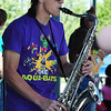 Drew Volz plays the saxophone for Hatrick Prenry during Broomstock 2012 at the Broomfield County Commons on Thursday.<br /> <br /> May 24, 2012 <br /> staff photo/ David R. Jennings