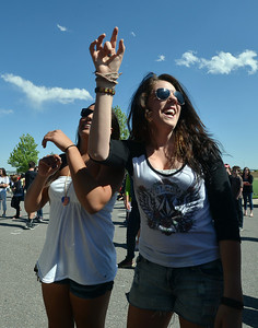 Maddie Rivas, 17, left, and Kelly Spencer, 17, dance  during Broomstock 2012 at the Broomfield County Commons on Thursday.  May 24, 2012  staff photo/ David R. Jennings