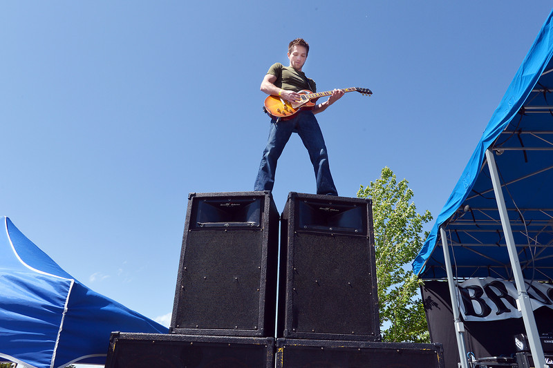 Andrew Newman with Taking Canyon plays the guitar on top of the speakers  during Broomstock 2012 at the Broomfield County Commons on Thursday.<br /> <br /> May 24, 2012 <br /> staff photo/ David R. Jennings