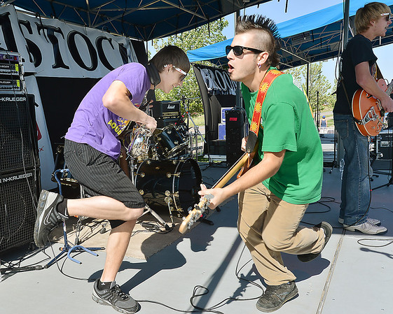 Hatrick Penry musicians, Ian Rosenstein, right, Guitar and Drew Volz, Sax dance on stage during Broomstock 2012 at the Broomfield County Commons on Thursday.<br /> <br /> May 24, 2012 <br /> staff photo/ David R. Jennings