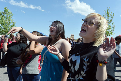 Jennifer Sandoval, 20, left, and Brooklyn Calbraith, 21, sing along to the rap music of  Michael Hubbard of  Miike during Broomstock 2012 at the Broomfield County Commons on Thursday.  May 24, 2012  staff photo/ David R. Jennings