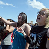Jennifer Sandoval, 20, left, and Brooklyn Calbraith, 21, sing along to the rap music of  Michael Hubbard of  Miike during Broomstock 2012 at the Broomfield County Commons on Thursday.<br /> <br /> May 24, 2012 <br /> staff photo/ David R. Jennings
