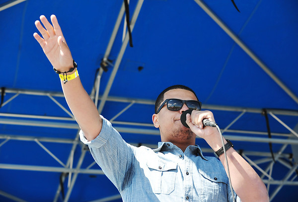 Rapper Michael Hubbard sings with his group Miike during Broomstock 2012 at the Broomfield County Commons on Thursday.<br /> <br /> May 24, 2012 <br /> staff photo/ David R. Jennings